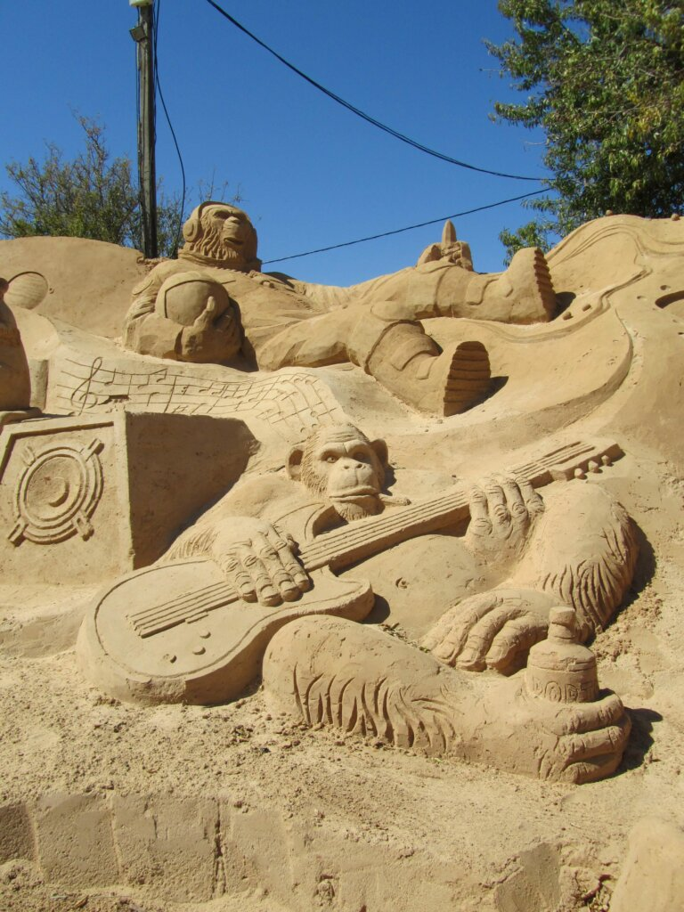 sand sculptures of musician apes