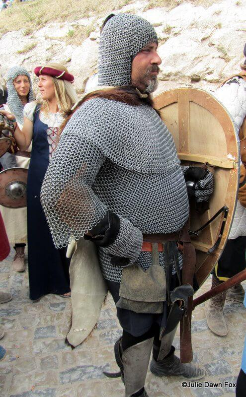 Actor dressed in chain mail for the Obidos Medieval Festival