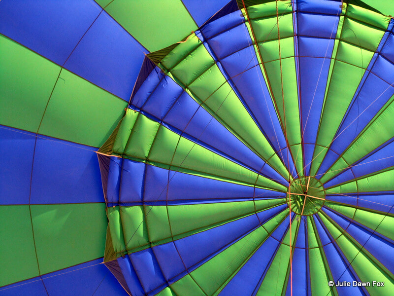 blue and green hot air balloon, inside