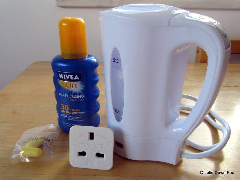 travel kettle, sun cream and adaptor