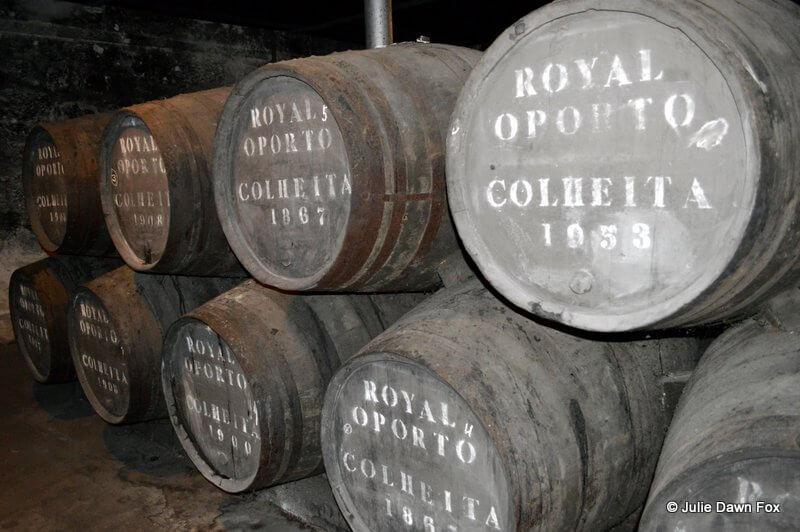 Stacked, old wooden port wine barrels