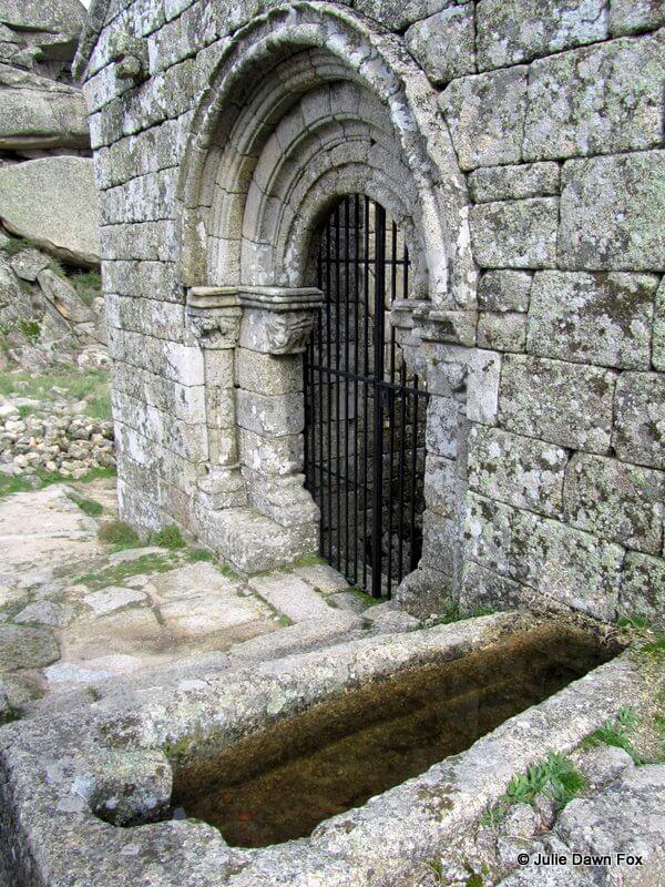 Stone tomb and Romanesque church doorway, Monsanto