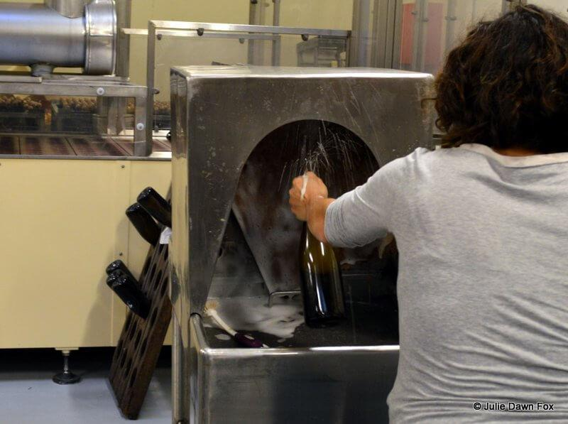 Checking for fizz in sparkling wine, Murganheira wine cellars, Douro valley, Portugal