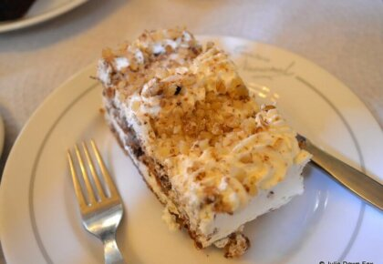 cream and sponge cake with chopped nuts