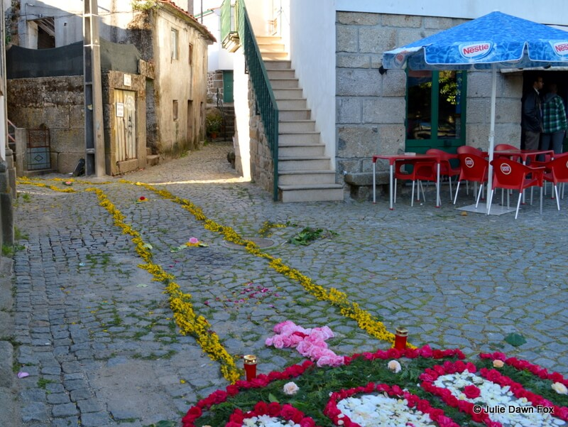 Path of flowers in the street leading to the church of Penalva do Castelo