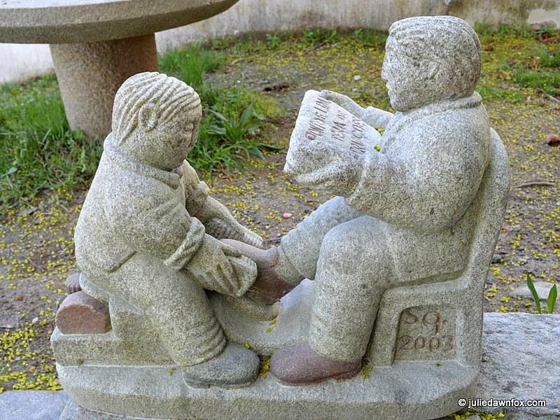 Shoe shine sculpture in stone