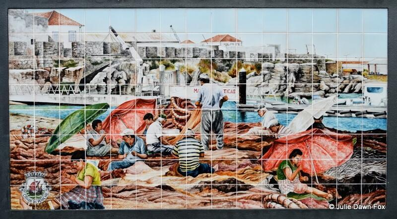 Azulejo panel showing fishermen and women at work in Peniche, Portugal