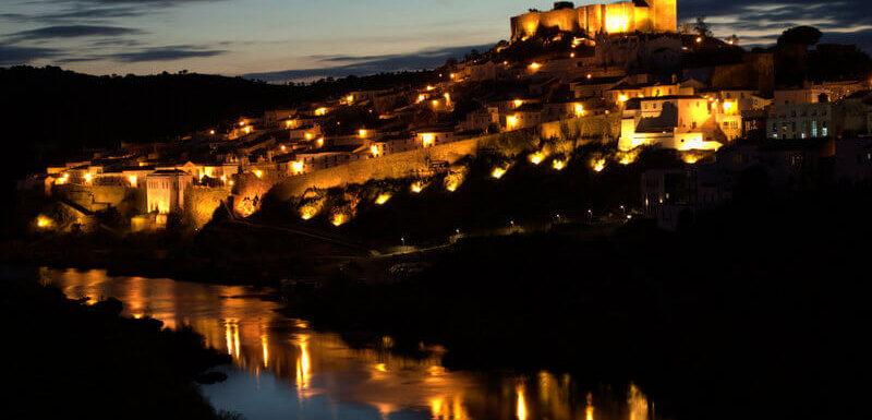 Medieval village of Mértola in the Alentejo region of Portugal at dusk. Photography by Julie Dawn Fox