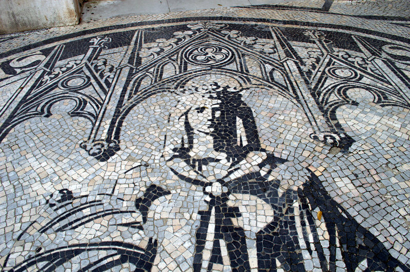 Watch your step! The streets are made of art with beautiful designs made from black and white cobblestones