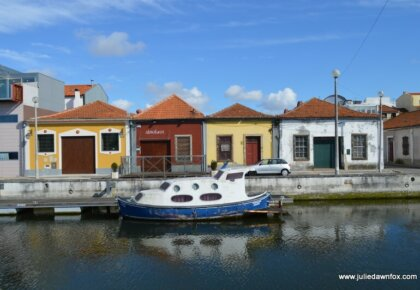 When you visit Aveiro, expect to see lots of boats and small houses, like these at Cais de São Roque, Aveiro