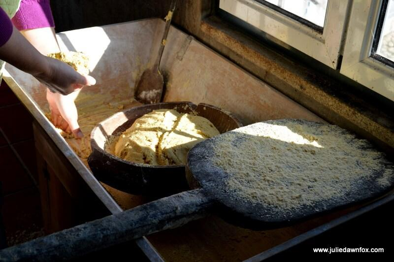 Broa dough with a lucky cross in it, Montaria, Serra d'Arga, Portugal. Photography by Julie Dawn Fox
