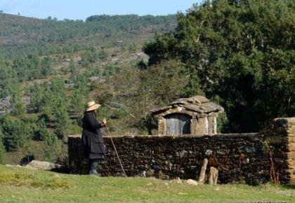 Village woman takes a break. Arga de Baixo, Serra da Arga, Minho, Portugal. Photography by Julie Dawn Fox