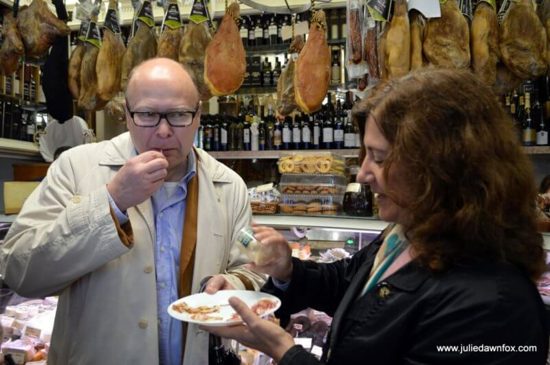 Tasting presunto in a traditional grocery store in Lisbon