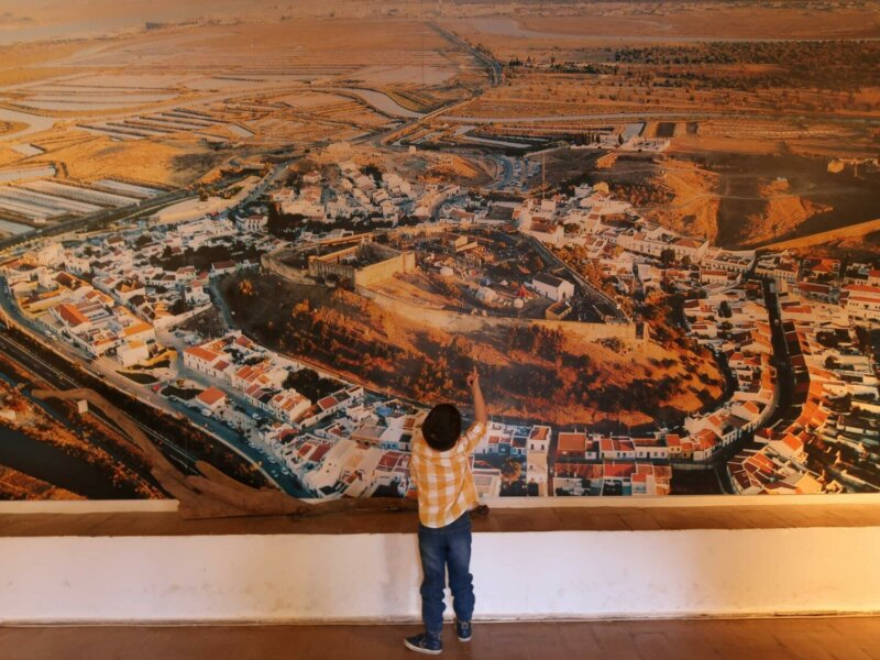 Child looking at the map inside Castro Marim Castle. Photo credit Passports and Adventures