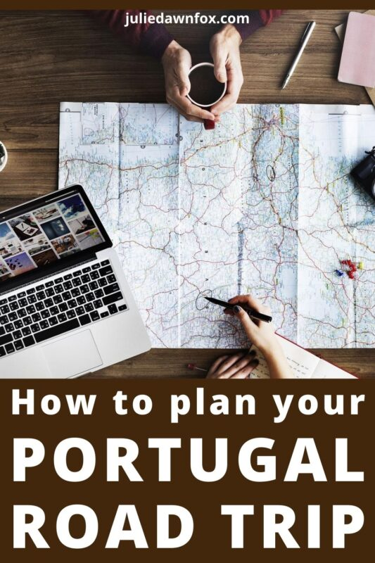 Road map and laptop. How To Plan Your Portugal Road Trip.