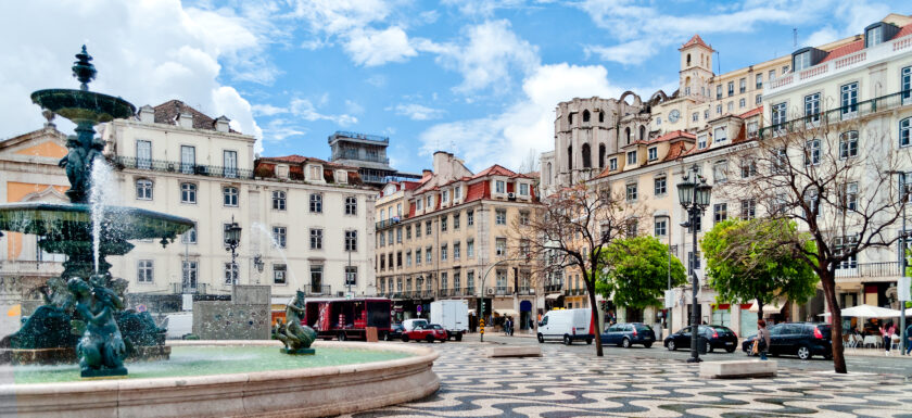 Fountain and wavy pavement on Rossio Square in Lisbon, Portugal