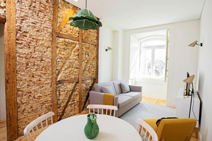 Round table and furniture at the Montebelo LX DWT Apartments, Lisbon