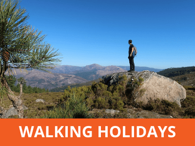 Man standing on a rock on a walking holiday in Portugal
